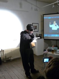 "Lorcan McGrane as ""Dermot H. Dark Materials""; the ""Darkest Comedian in Ireland"", Safehouse Art Gallery, 2009"